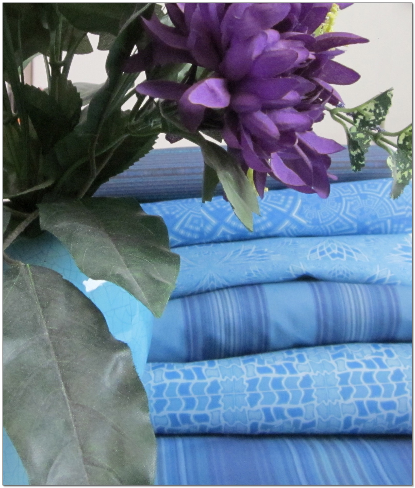 A stack of Gingezel blue fabric.